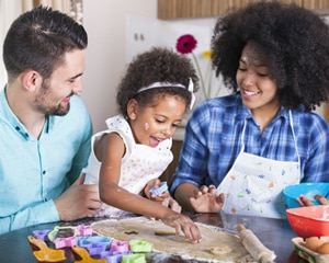child cooking with parents