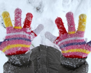 Colorful mittens on a child's hands